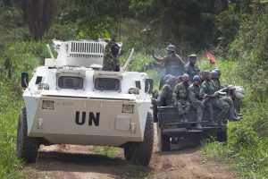A MONUSCO APC is greeted by FARDC soldiers on their way back from the front line in the Beni region where the UN is backing the FARDC in an operation against ADF militia, the 13th of March 2014. © MONUSCO/Sylvain Liechti