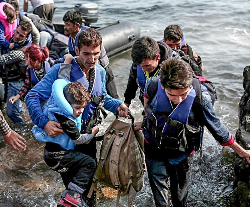 "Photo of Syrian refugees coming ashore on the Greek island of Lesbos that accompanied the Guardian's editorial (9/3/15) condemning ""the refusal to intervene against Bashar al-Assad."" (photo: Angelos Tzortzinis/Getty)"